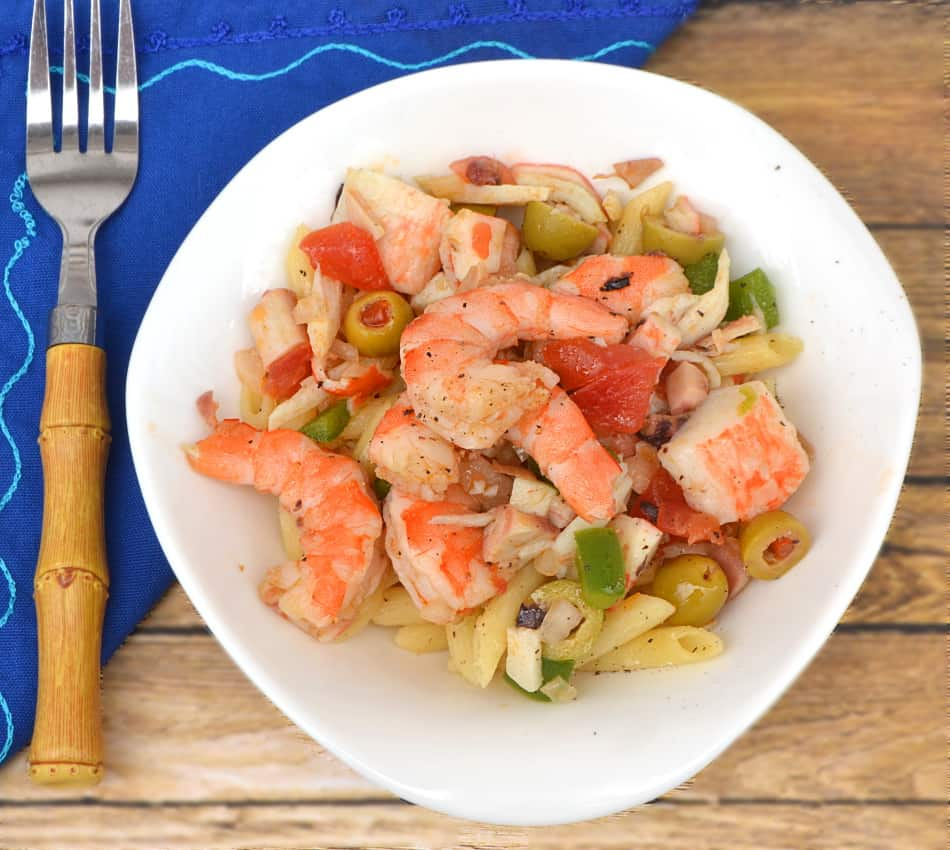 Spanish Seafood Salad with shrimp, crab, octopus, veggies & olives. Loaded with fresh, bold flavor & just the right amount of heat | www.craftycookingmama.com