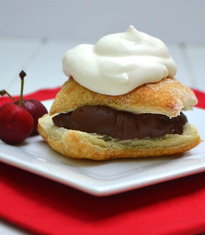 Rich chocolate ganache layered between flaky Puff Pastry and topped with homemade whipped cream. Absolute dessert perfection   www.craftycookingmama.com