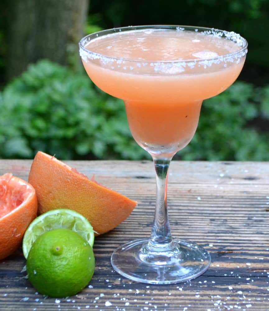 The Perfect Grapefruit Margarita. We're going back to basics here. A grapefruit, a lime, tequila and perhaps a drizzle of agave. Cheers | www.craftycookingmama.com