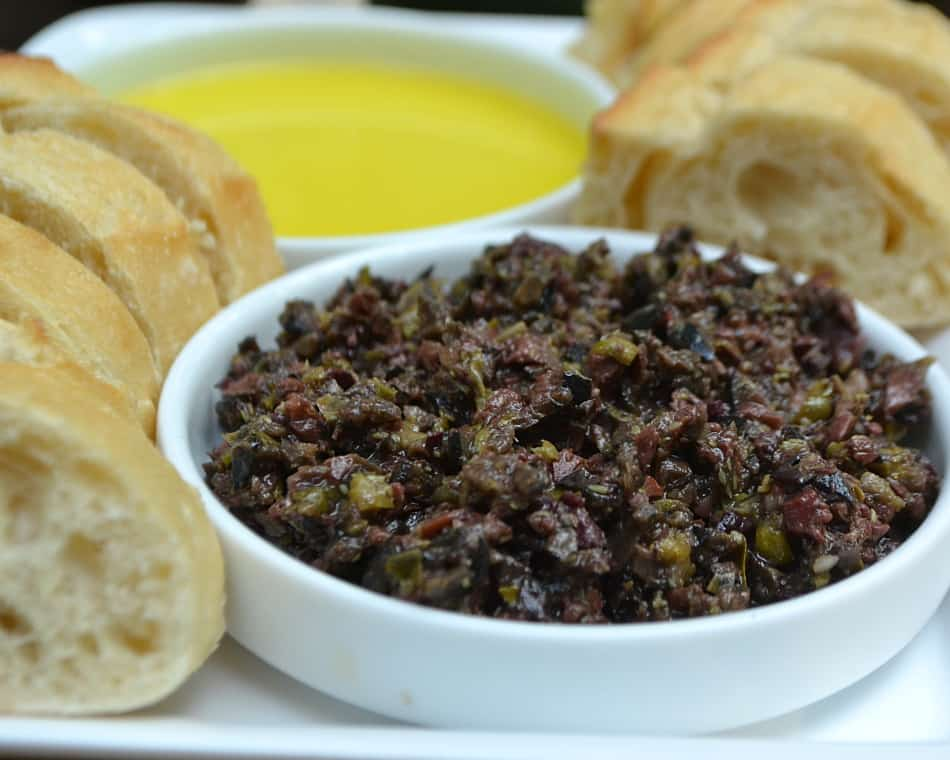 Try this simple & delicious Olive Tapenade made with black and kalamata olives, olive oil, capers, anchovies & garlic   www.craftycookingmama.com