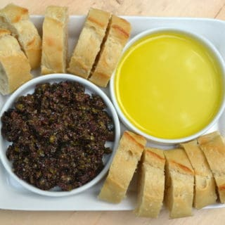 Try this simple & delicious Olive Tapenade made with black and kalmata olives, olive oil, capers, anchovies & garlic | www.craftycookingmama.com