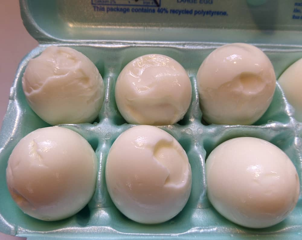 perfectly cooked and peeled hard boiled eggs an egg