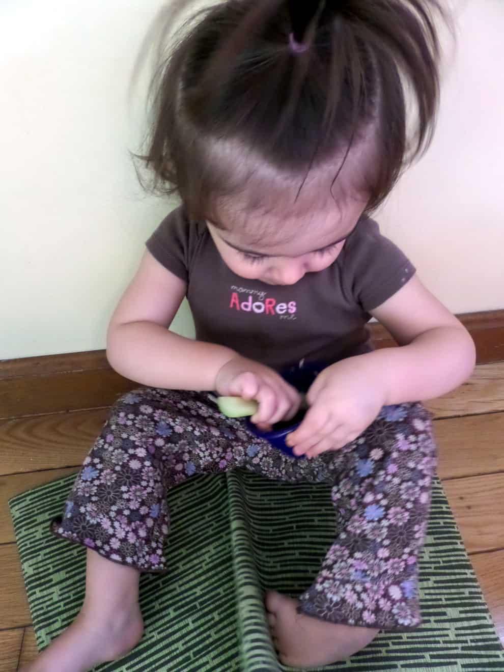 Baby Genevieve snacking on Peanut Butter apple celery dip