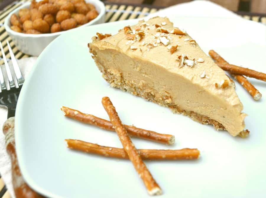 Sweet and salty peanut butter cheesecake pie in a pretzel crust | Rich & creamy with a crunch | So easy - pie filling is no bake | craftycookingmama.com