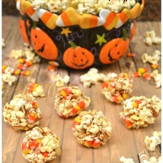 Bringing back an old favorite - Popcorn Balls   Made with Marshmallow, Candy Corn, Pretzels & Peanuts   Kids & Adults Love this Halloween Treat   craftycookingmama.com