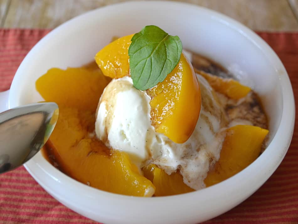 Canned Peaches Made Delicious | Save the Heavy Syrup & Reduce with Balsamic & Served Over Vanilla Ice Cream | www.craftycookingmama.com
