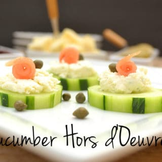 Cucumber hors d'oeuvres with Garlic & Fine Herbs Cheese, smoked salmon & capers. Simple, fancy & delicious | www.craftycookingmama.com