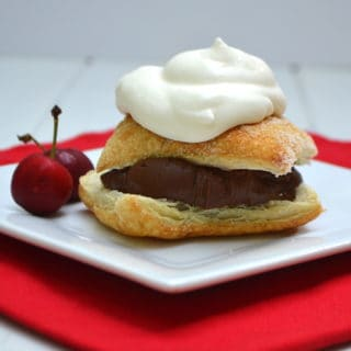 Rich chocolate ganache layered between flaky Puff Pastry and topped with homemade whipped cream. Absolute dessert perfection | www.craftycookingmama.com