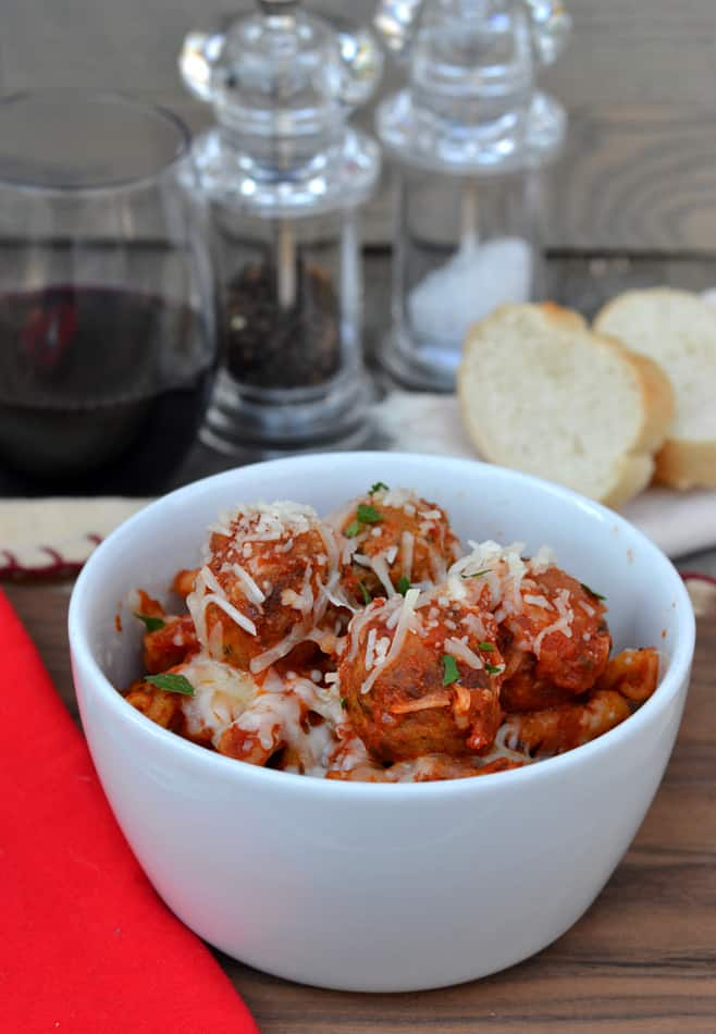 This quick, delicious & hearty one pot pasta & meatball recipe is perfect for all your busy nights!  Get dinner on the table in less than half an hour | www.craftycookingmama.com