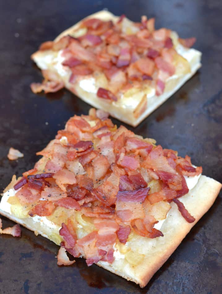 Flammkuchen - a traditional German pizza topped with creme fraiche and smothered in sauteed onions & crisp bacon.